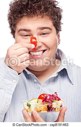 chubby man with fresh salad - csp8191463