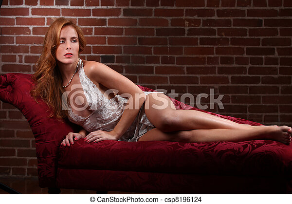 Red Head Woman Wearing Lingerie in Seductive Poses - csp8196124