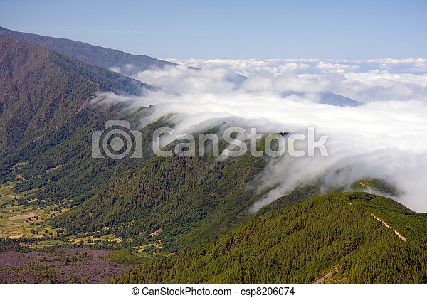 Clouds falling over the mountain ridge of La Palma, Canary Islands - csp8206074