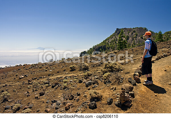 Boy in volcanic landscape at La Palma, Canary Islands - csp8206110