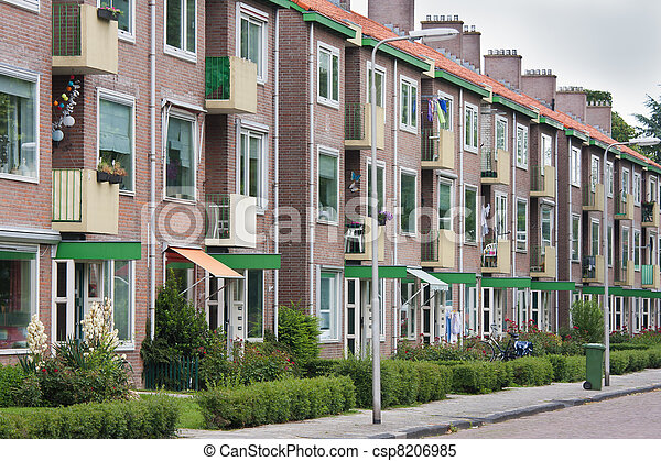 Typical Dutch residential street with flats - csp8206985