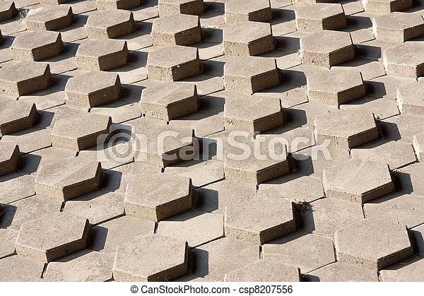 Stock beeld van buiten helling symmetrisch zeshoekig stenen csp8207556 zoek naar for Lay outs buiten helling