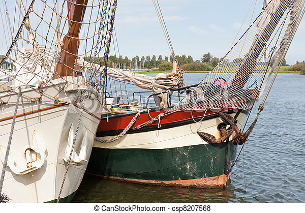 Bow of two old schooners in Dutch harbor Kampen - csp8207568