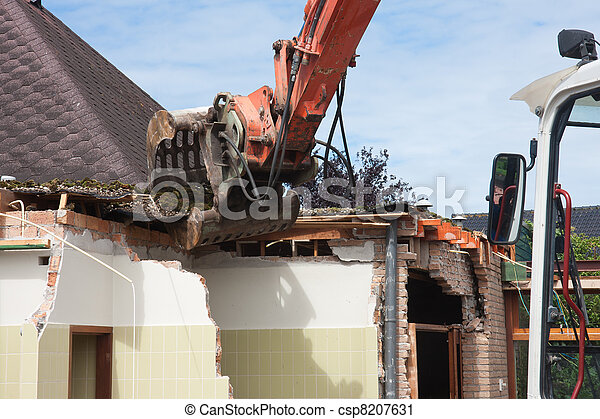 Destruction of a building by a caterpillar crane - csp8207631