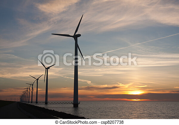 Dutch offshore windturbines during a beautiful sunset - csp8207738
