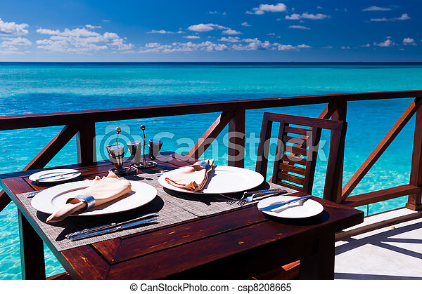 Table setting at beach restaurant - csp8208665