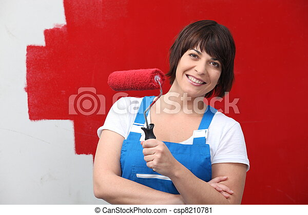 Woman painting wall in red - csp8210781