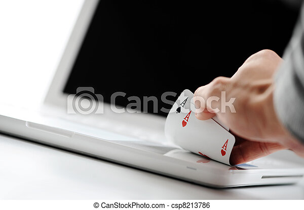 poker online, poker cards on white laptop - gambling concept photo - csp8213786