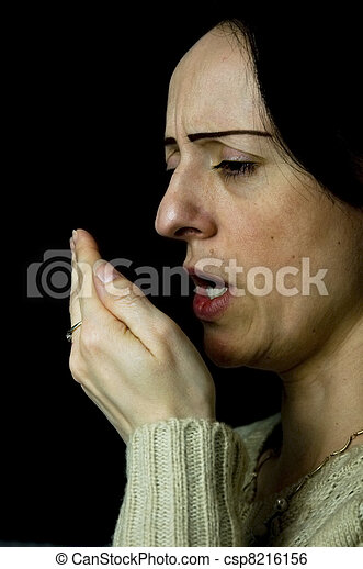 Stock Photo - woman coughing, sneezing into hand - stock image, images ...