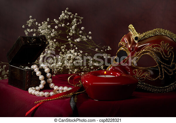 sadness. abstract still life over red fabric - csp8228321