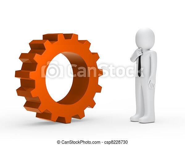 Business man orange mechanical gear - csp8228730