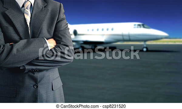 Businessman in front of private jet  - csp8231520
