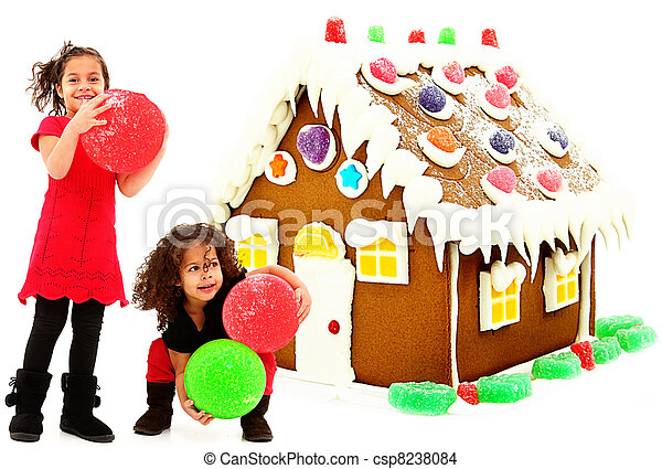 Two Beautiful Preschool African Hispanic Sisters Building Giant Gingerbread House over white background.  - csp8238084