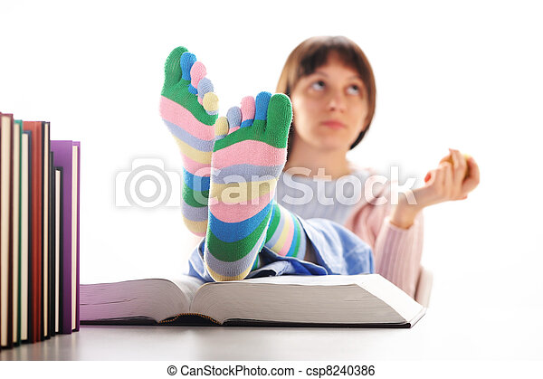 Tired of studies, student  with his feet up on his desk, similar pictures on my portfolio - csp8240386