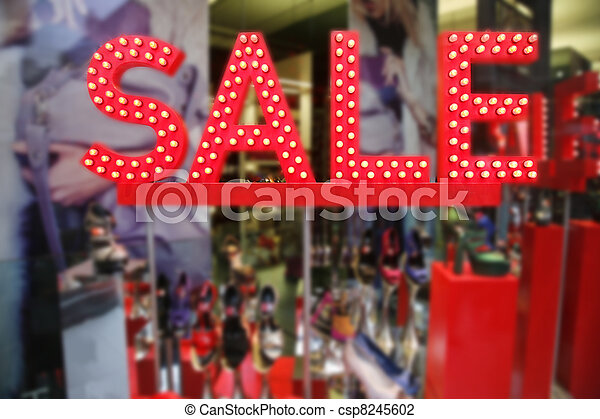 Sale signs in shop window - csp8245602