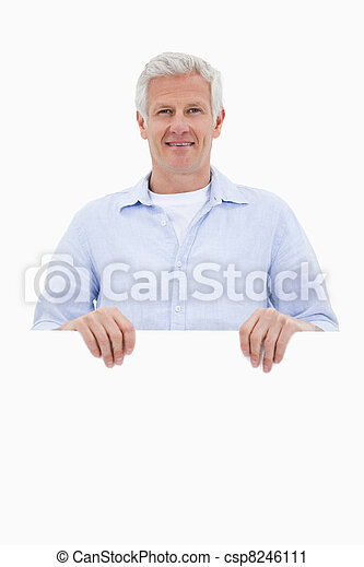 Portrait of a mature man standing behind blank board - csp8246111