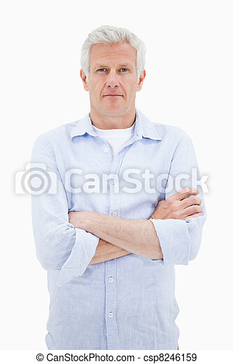Portrait of a mature man with the arms crossed - csp8246159