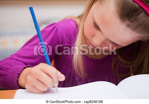 Close up of a schoolgirl writing - csp8246198