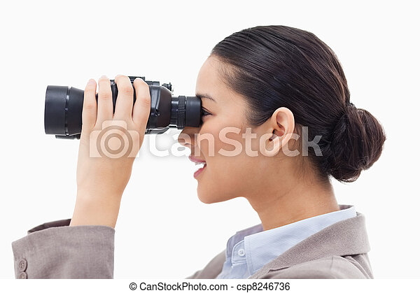 Side view of a businesswoman looking through binoculars - csp8246736