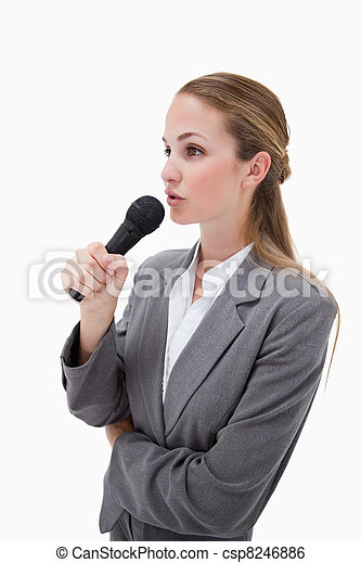 Side view of woman with microphone - csp8246886