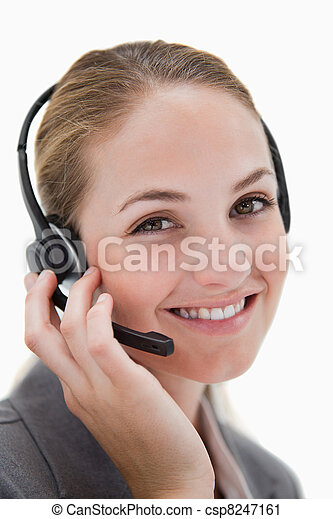 Happy smiling call center agent at work - csp8247161