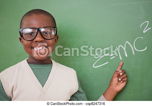 Smart schoolboy showing the the mass-energy equivalence formula - csp8247316