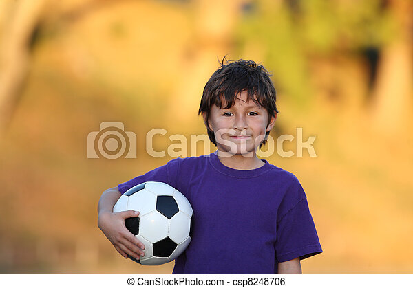 Boy with soccer ball at sunset - csp8248706
