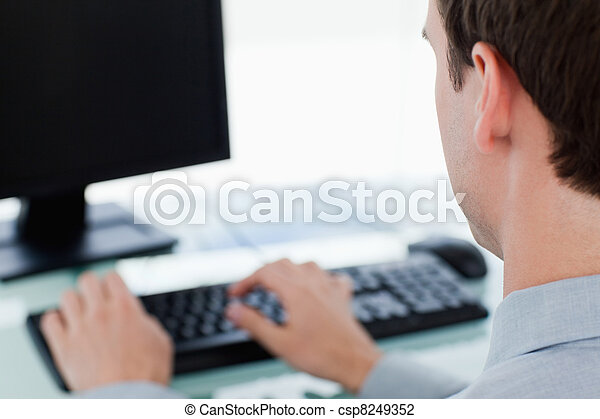 Back view of a businessman working with a monitor - csp8249352