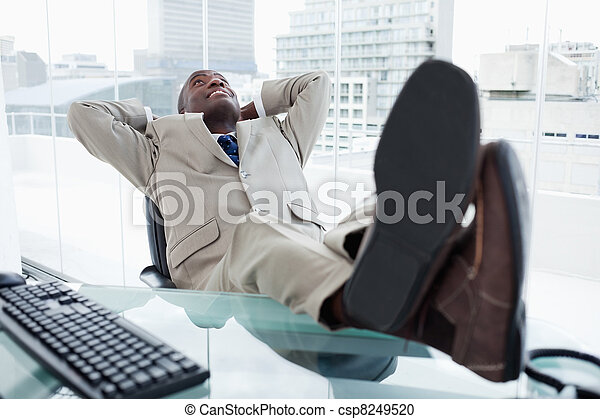 Happy businessman relaxing - csp8249520