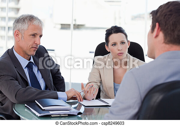 Business team negotiating with a customer - csp8249603