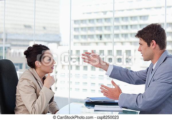 Serious business team negotiating - csp8250023