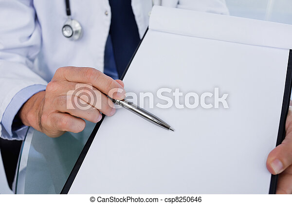 Close up of a male doctor showing a blank document - csp8250646