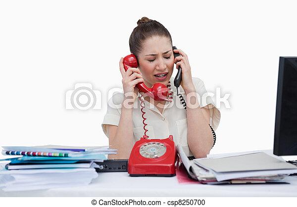 Stock fotografie van telefoons secretaresse beantwoorden jonge beklemtoonde csp8250700 - Secretaresse witte ...