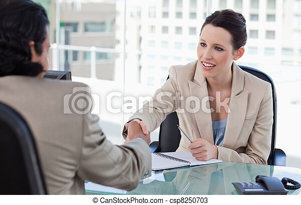 Manager shaking the hand of a male applicant - csp8250703
