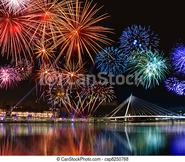 Colorful fireworks near water - csp8250768
