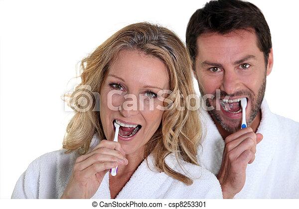 woman and man brushing teeth - csp8253301