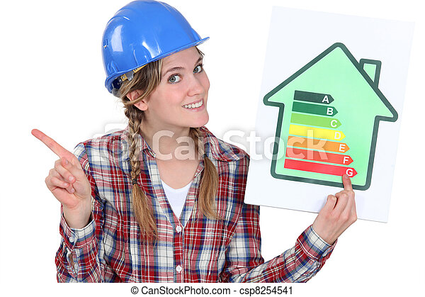 craftswoman holding an energy consumption label - csp8254541