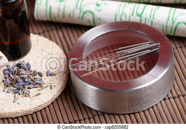 Acupuncture needles, moxa sticks and lavender petals - csp8255882