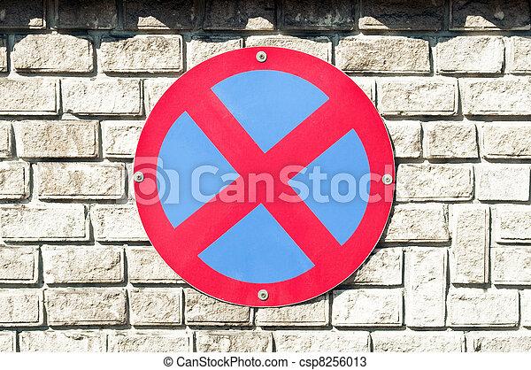 No parking sign on brick wall - csp8256013