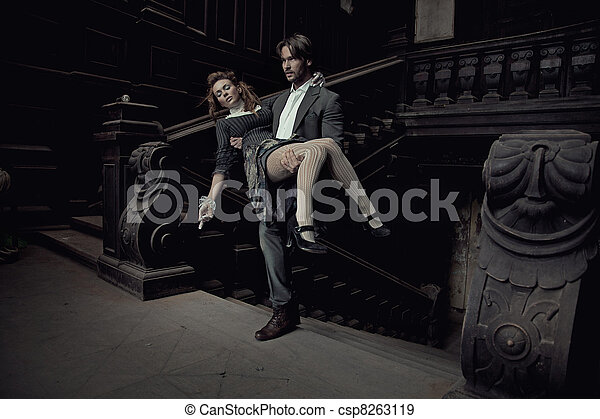 Elegant man carrying a beautiful brunette - csp8263119