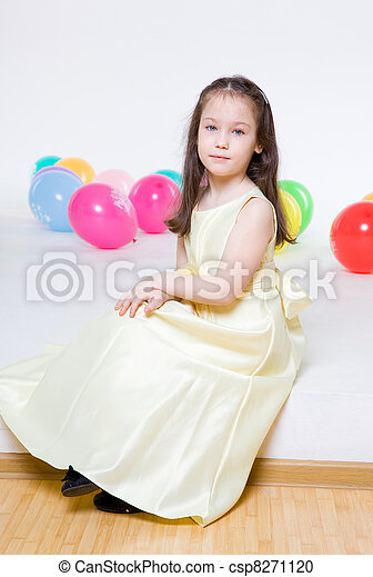 five years\' girl with long hair with an elegant dress