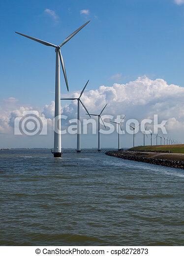 windfarm along a dike - csp8272873