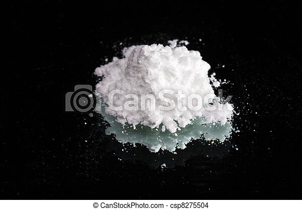 Cocaine drugs heap on a black mirror, close up view - csp8275504
