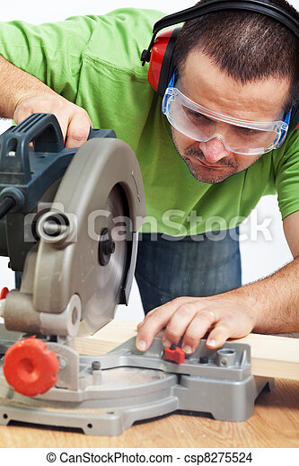 Carpenter or joiner working with power tool - csp8275524