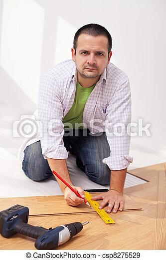 Home improvement - laying laminate flooring - csp8275529