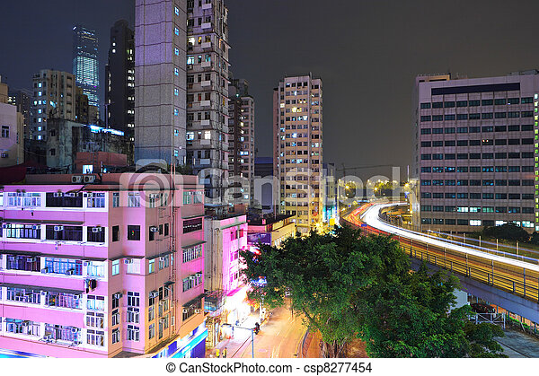 Hong Kong with crowded buildings at night - csp8277454