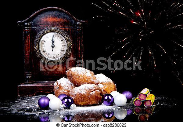 Dutch oliebollen and clock on midnight - csp8280023