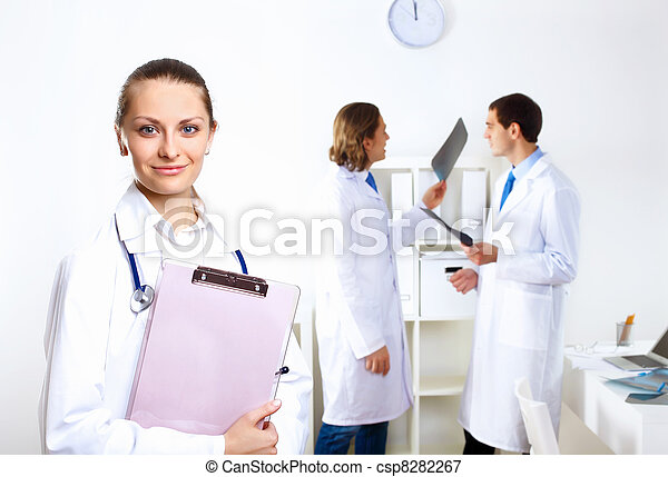 Friendly doctor in medical office - csp8282267