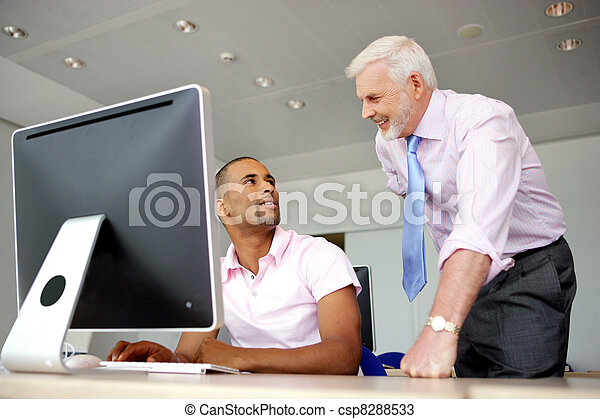 computer specialist and his boss - csp8288533