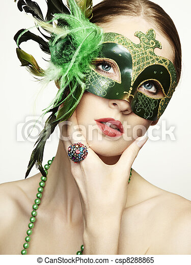 The beautiful young woman in a green mysterious venetian mask  - csp8288865